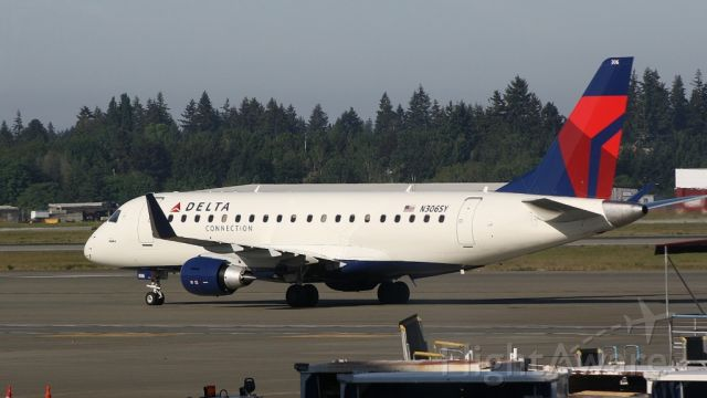 Embraer 170/175 (N306SY) - Picture taken from inside the terminal by gates c16, Delta E170 was just taxiing by