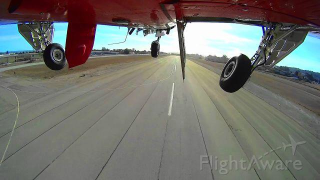 Beechcraft Bonanza (33) (N8943U) - Departure on RW20 and gear up at Watsonville