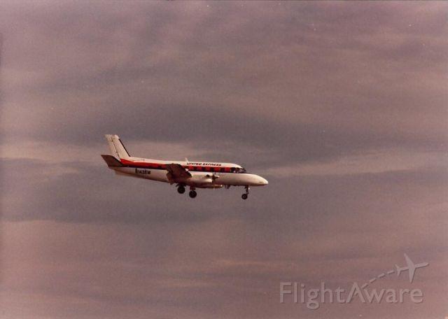 Embraer EMB-110 Bandeirante (N143EM) - United Express Embraer landing at Santa Ana in the late 1980s