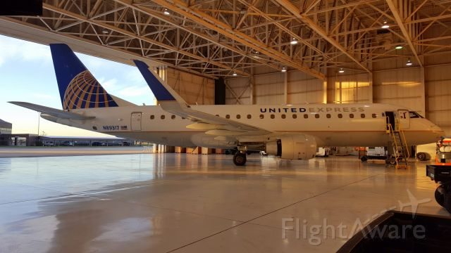Embraer 170/175 (N89317) - Early morning in the hangar, just after sunrise.