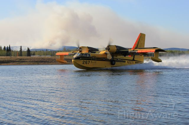 — — - 267 scooping with the forest fire in the background.