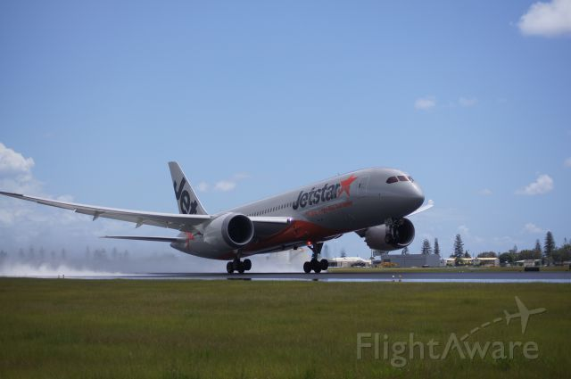 Boeing Dreamliner (Srs.8) — - Jetstar 11 for Narita Japan rotates off a very wet Runway 14 at Gold Coast Airport