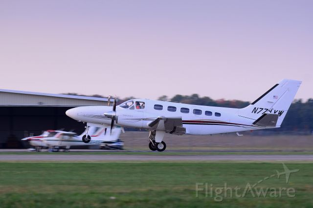 Cessna Conquest 2 (N771XW) - Dusk departure on runway 26