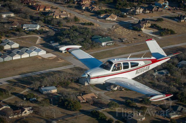 Beechcraft 35 Bonanza (N2054N) - Flying over home airport