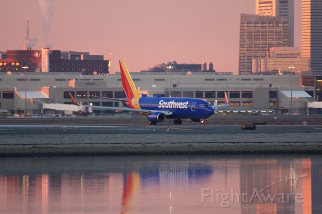 Boeing 737-700 (N7880D) - Southwest B737 departing BOS for Chicago Midway at sunrise on 1/11/21.