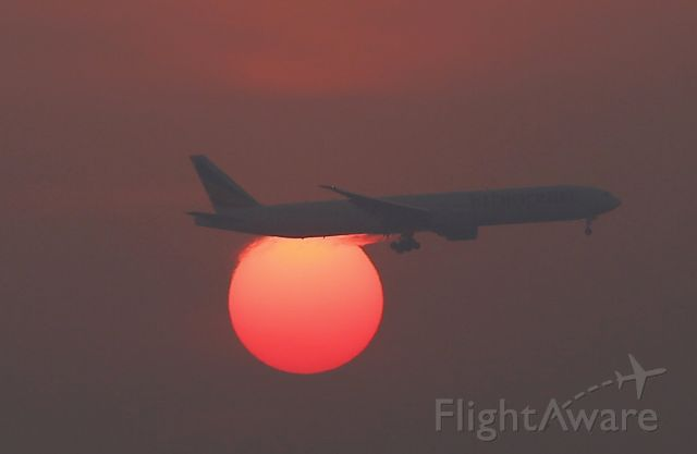 — — - A plane flies over the setting sun in the sky at Beijing International Airport, China, March 2, 2016. (Photo by Kim Kyung-Hoon/Reuters)