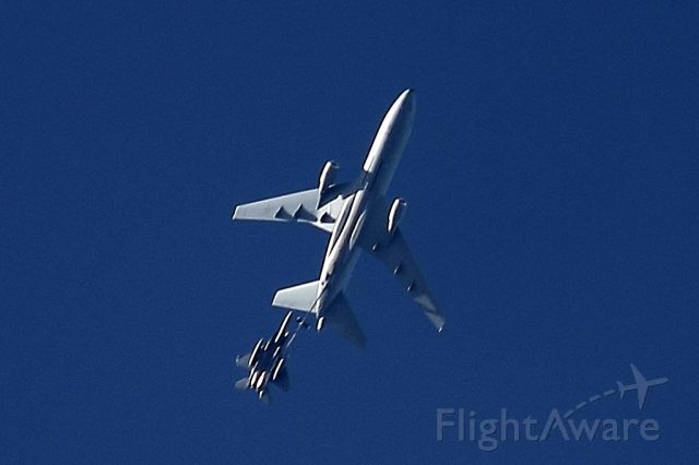 McDonnell Douglas DC-10 (87-0120) - Apologies for the quality... There is only so much that can be done with 250mm. This photo was taken from Coral Springs, FL, with the refueler and F-15 togther at about 23,000 feet going 400+ knots ground speed.
