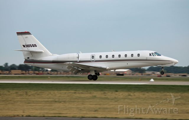 Cessna Citation Sovereign (N305QS) - A NetJets Sovereign touches down on runway 27 at Oshkosh, bringing Steve Miller into town for a concert the following night. Pictured during EAA AirVenture 2012.