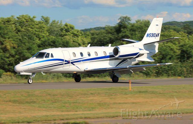 Cessna Citation Excel/XLS (N590AK) - N590AKs new paint scheme! Just after touchdown on runway 2.