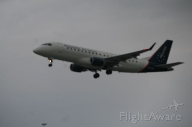 Embraer 175 — - Heading off the CLT on a gloomy day