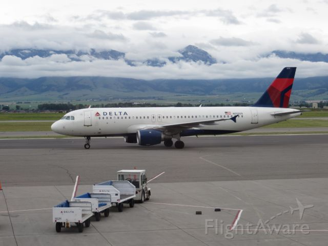 Airbus A320 (N321US) - Watching planes with low clouds covering the Bridger Range from the terminal