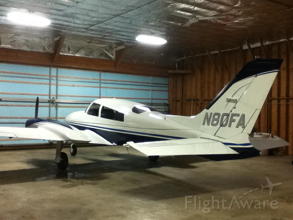 Cessna 310 (N80FA) - In the hangar after a quick wash.