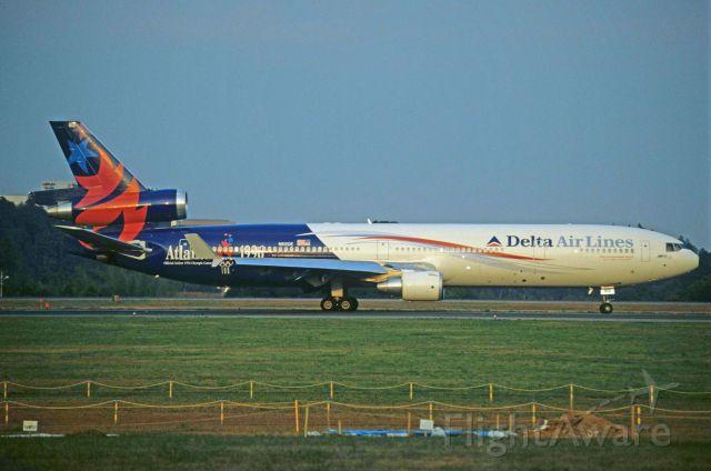 "Boeing MD-11 (N812DE) - Departure at Narita Intl Airport Rwy16R on 1996/10/19 "" Atlanta Olympic c/s """