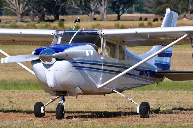 Cessna Centurion (VH-CXT) - Beautiful clean paint on this 1960 Cessna C210.
