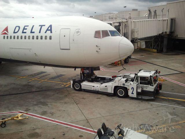 BOEING 767-300 (N156DL) - Tug pulling B767 to gate