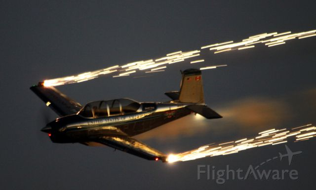 """Beechcraft Mentor (N134JC) - Julie Clark, once a Stewardess for TWA, is a retired Northwest Airline Pilot, now aerobatic Stunt Pilot flies her T34, known as """"Free Spirt"""" and """"Air Force One Half"""" performs to the music of Country Music Artist Lee Greenwood"""
