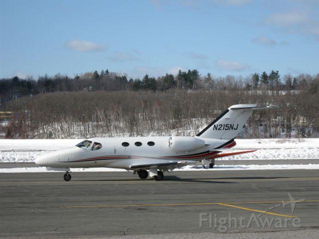 Cessna Citation Mustang (N215NJ) - Taxiing in a winter wonderland.