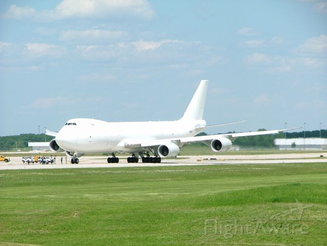 BOEING 747-8 (N6009F) - Rare shot of Boeing 747-8 landing at KGRR. Note airport personnel watching from taxiway.