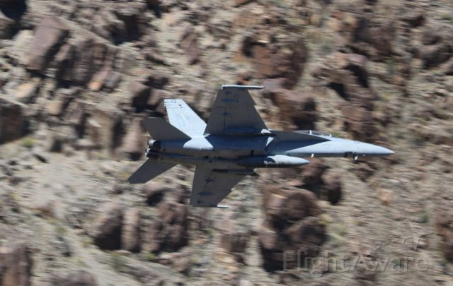 H3 — - Bottom view of Navy plane exiting the Jedi Transition. Low level training area in Death Valley, California.