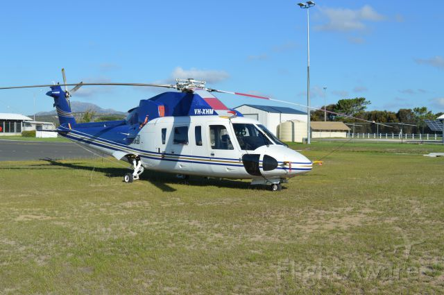 Sikorsky S-76 (VH-XHM) - Helicopter Resources S76 parked on western grass apron at Flinders, Feb 2016
