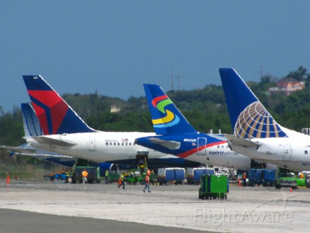— — - Airplanes parked at Sangster International Airport, Montego Bay, Jamaica