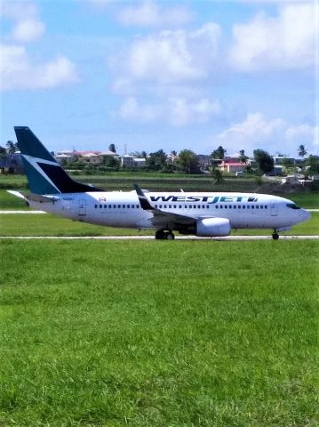 Boeing 737-700 (C-GQWJ) - WS#2513, a 737-700 WestJet  aircraft on departure roll on runway 09 at Barbados for the nearly 6 hour flight to Toronto Lester B. Pearson International