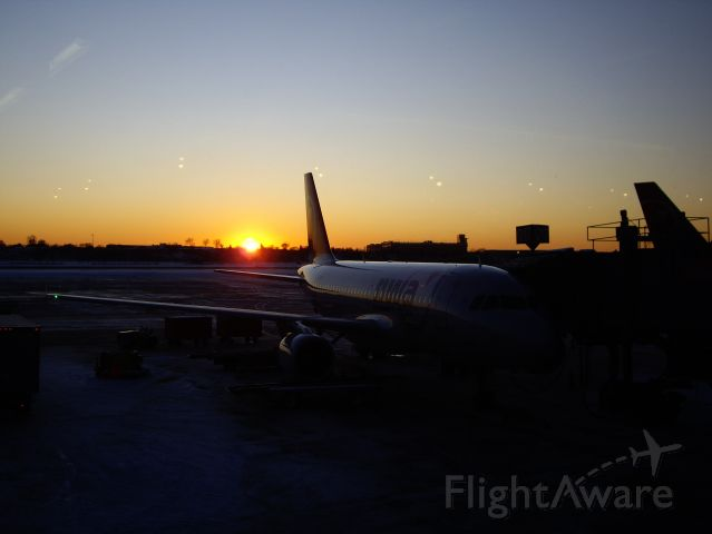 Airbus A319 — - Waiting to depart in the last cold light of day