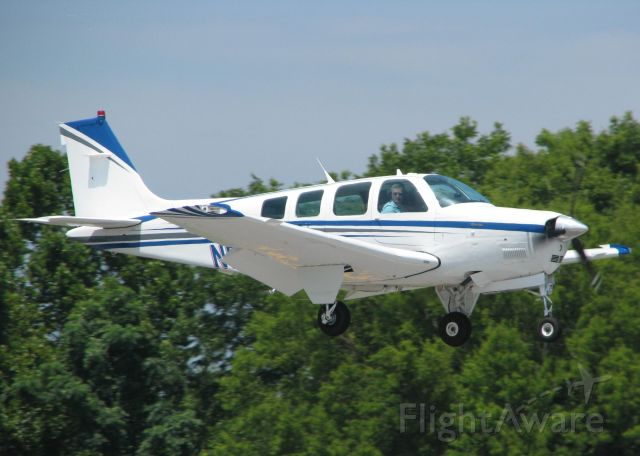 Beechcraft Bonanza (36) (N56539) - Landing on runway 14 at the Shreveport Downtown airport.