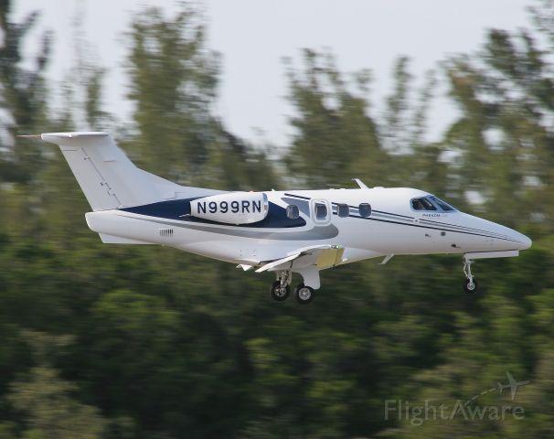 Embraer Phenom 100 (N999RN) - An Embraer Phenom 100 landing at Naples, Florida.  Photo by Erick Stamm.