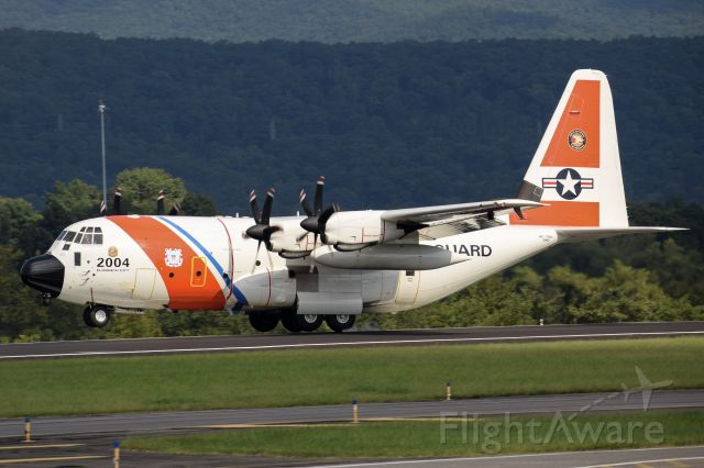 — — - US Coast Guard C-130 performing a touch and go