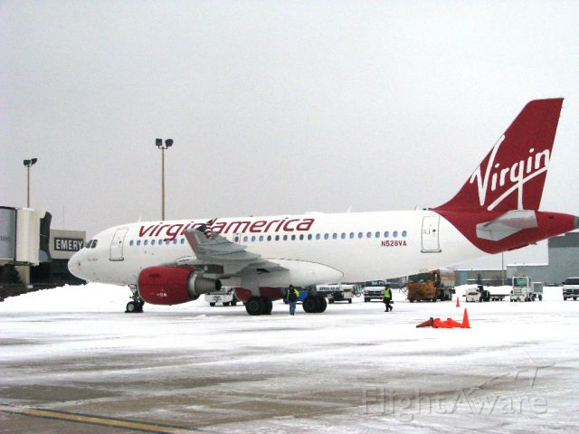 Airbus A319 (N528VA) - VA arrival at RFD following one of many snow storms during this past winter