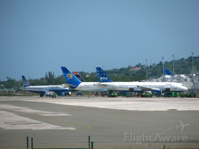 — — - Planes parked at Sangster International Airport