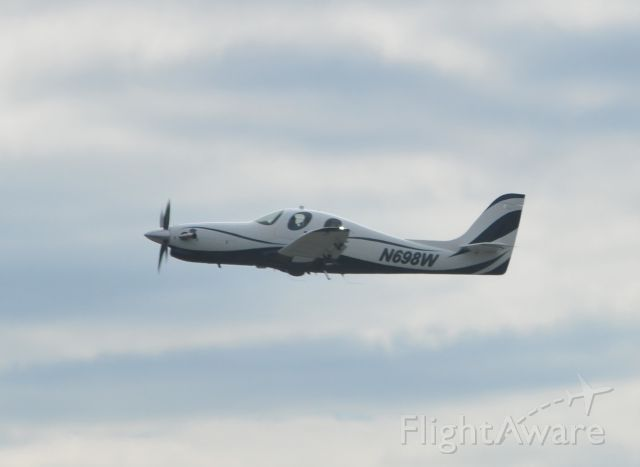 Lancair Evolution — - Lancair Evolution on climb out from Frederick Airport (FDK) in Maryland.