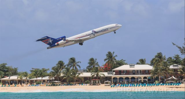 BOEING 727-200 (N495AJ) - Gone are the past where could of relax on the beach while watching the wonderful view of them metal birds zoom by. Here we have Amerijet Boeing 727 Registration N495AJ seen departing St Maarten for MIA.