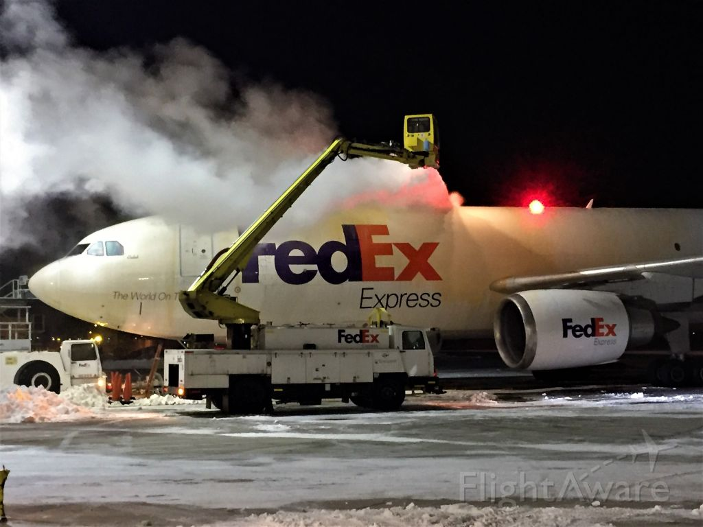 """Airbus A300F4-600 (N671FE) - Airbus 300-6F """"Caleb"""" getting a heavy dose of Type 1 Deicing Spray on the top of the fuselage.<br />5 F temperatures but fortunately little wind."""