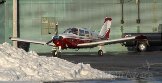 Piper Cherokee (N913FL) - Our Arrow taxiing away from the pumps, home with a bright new paint job.
