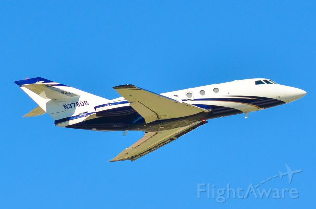 Dassault Falcon 20 (N378DB) - Leaving Austin from 35R into a light north breeze.