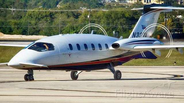Piaggio P.180 Avanti (N327A) - Exiting 31L after arrival.