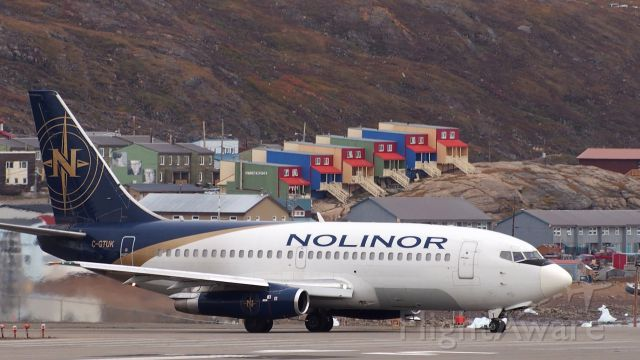 Boeing 737-200 (C-GTUK) - Preparing to leave Iqaluit airport.  The skid plate on the front wheel prevents gravel from puncturing the fuselage on unpaved runways. Nolinors 737-200 were featured on an episode of Mighty Planes.