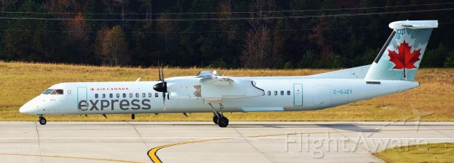 de Havilland Dash 8-400 (C-GJZY) - Well now! Here's an extremely rare visitor to RDU - in fact, I've never seen a Jazz Dash here before at all.  This was a neat surprise.  From the RDU observation deck, 11/26/18.