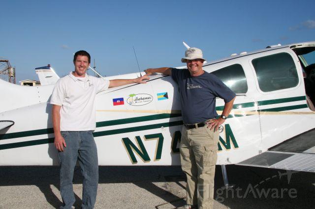 Beechcraft 55 Baron (N74EM) - Steve Merritt and Abraham McIntyre at Governors Harbor, Eleuthera.