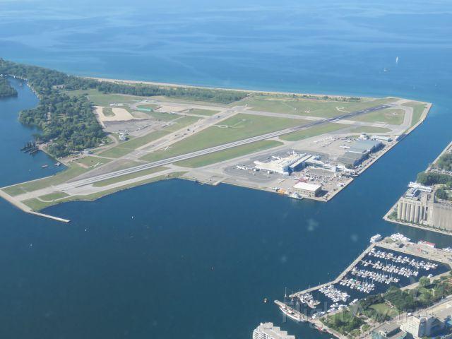 de Havilland Dash 8-400 — - Toronto City Airport as seen from atop the CN Tower