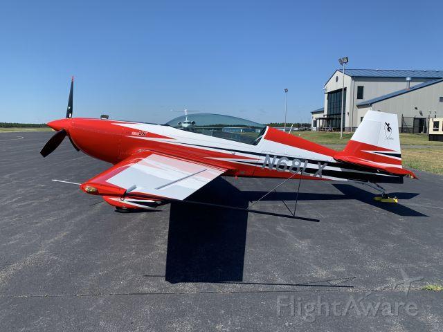 EXTRA EA-300 (N68LX) - Slick Extra 330LX on the ramp at MJX.