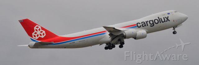 BOEING 747-8 (LX-VCD) - Notice the vortices coming off the engines, and vapor forming on wings