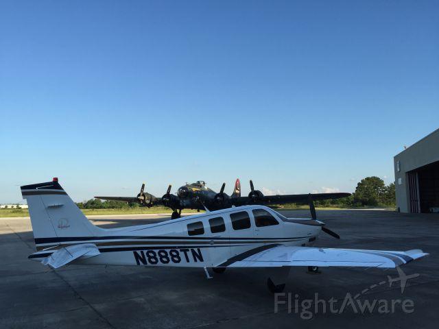 Beechcraft Bonanza (36) (N888TN) - Two birds. Two missions. Both beauties.