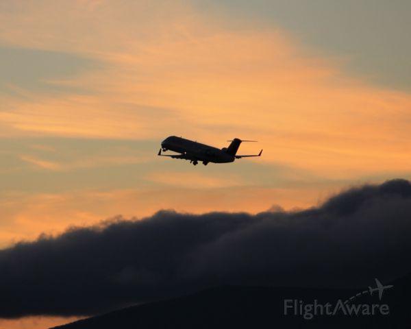 Canadair Regional Jet CRJ-200 (N914EV) - Departing Roanoke's runway 24 into the sunset, bound for Atlanta.