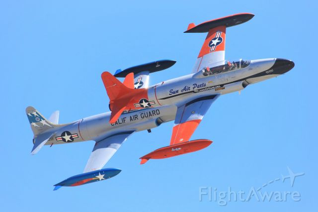 Lockheed T-33 Shooting Star (N377JP) - The Planes of Fame's CT-133 Mk 3PT Silver Star makes a pass in formation with Palm Springs Air Museum's T-33B Shooting Star at the Planes of Fame Airshow 2019..