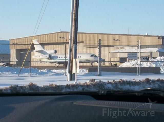 Dassault Falcon 7X (N173CN) - Dassault Falcon 7x sitting by the hangar at Bradley Intl. Airport.