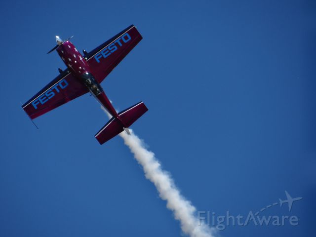 EXTRA EA-300 (N46EX) - Extra 300 Performing stunts at the 2012 Watsonville fly-in airshow.