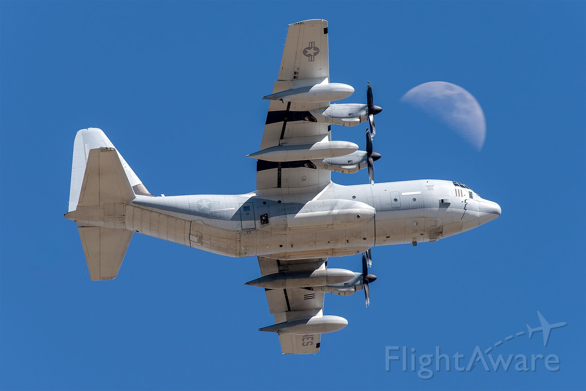 """Lockheed C-130 Hercules (16-7111) - KC-130J of the VMGR-234 """"Rangers"""" passes in front of the moon at NAS Fort Worth JRB."""